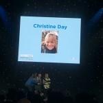 Chritine receives her award.